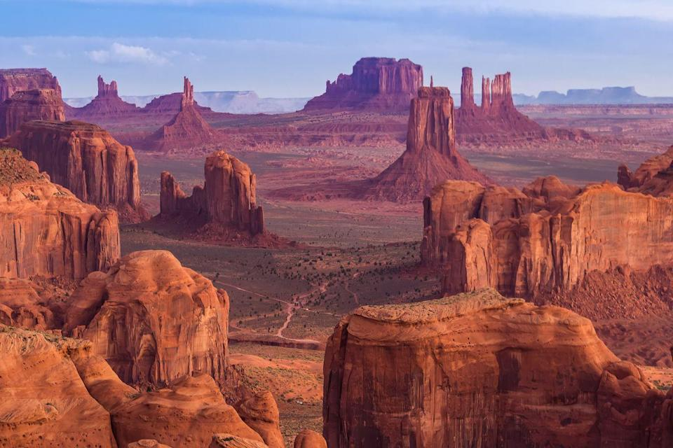 """<p>You've seen it in the movies–the iconic stretch of highway leading seemingly nowhere–marvelous red, sandstone formations rising sharply from the desert floor on each side of the deserted street. The wild landscape of Monument Valley, though seen plenty on late-night West World binges, must be seen to be believed. </p><p>The stark natural beauty of this landscape, while breathtaking in pictures, doesn't cut it in a photo. While the difficult part is getting there, the divine Amangiri property is located just two hours west and some of the best views are best seen by car en route to and from the property. Using <a href=""""https://www.aman.com/resorts/amangiri"""" rel=""""nofollow noopener"""" target=""""_blank"""" data-ylk=""""slk:Amangiri"""" class=""""link rapid-noclick-resp"""">Amangiri</a> as a base to explore all of Utah's National Parks–Bryce, Moab, Canyon Point–ensures maximum luxury and ample time for exploration. Upon first sighting Monument Valley, it becomes clear why it's ranked as one of the best views in the world. If time is on your side, head East from Amangiri for a stay at <a href=""""http://duntonhotsprings.com/"""" rel=""""nofollow noopener"""" target=""""_blank"""" data-ylk=""""slk:Dunton Hot Springs"""" class=""""link rapid-noclick-resp"""">Dunton Hot Springs</a>, an astonishingly remote cluster of luxurious cabins in a formerly a derelict mining town that has been carefully renovated and curated to a T.</p>"""
