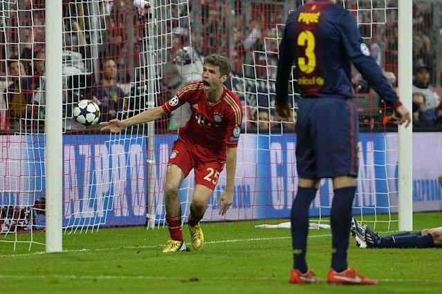 Bayern's Thomas Mueller (L) reacts after scoring the fourth goal during their UEFA Champions league first leg semi-final football match against Barcelona at the Allianz arena in Munich on April 23, 2013. Bayern Munich won 4-0
