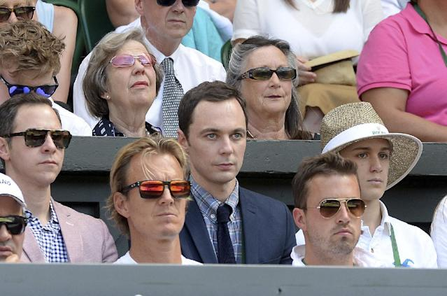 U.S. actor Jim Parsons, centre, watches from the players box duirng the Wimbledon women's semifinal match between Canada's Eugenie Bouchard and Romania's Simona Halep at the All England Lawn Tennis Championships in Wimbledon, London, Thursday July 3, 2014. (AP Photo/Anthony Devlin/PA)