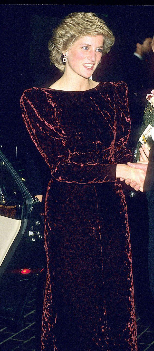 <p>In a dark red velvet gown attending the premiere of <em>Back to the Future</em>. </p>
