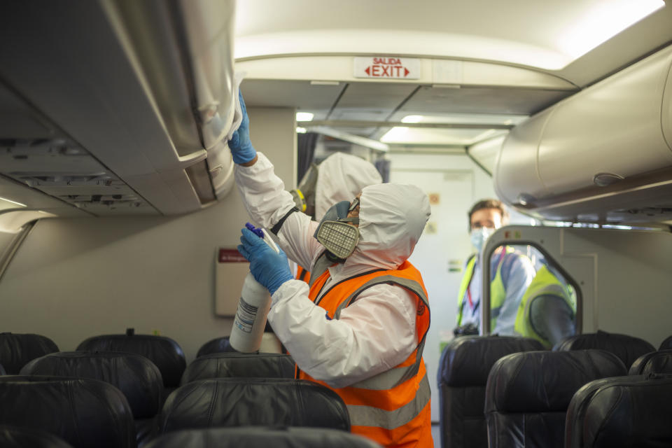 Person disinfects a commercial airplane of the Latam company on September 9, 2020 in Bogota Airport, Colombia. (Photo by Daniel Garzon Herazo/NurPhoto via Getty Images)