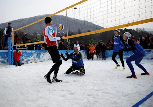 Pyeongchang 2018 Winter Olympics - Pyeongchang - South Korea – February 14, 2018. Giba Godoy of Brazil returns the ball to Nikolas Berger of Austria during an event promoting the Snow Volleyball hosted by the International Volleyball Federation (FIVB) and European Volleyball Confederation (CEV). REUTERS/Kim Hong-Ji
