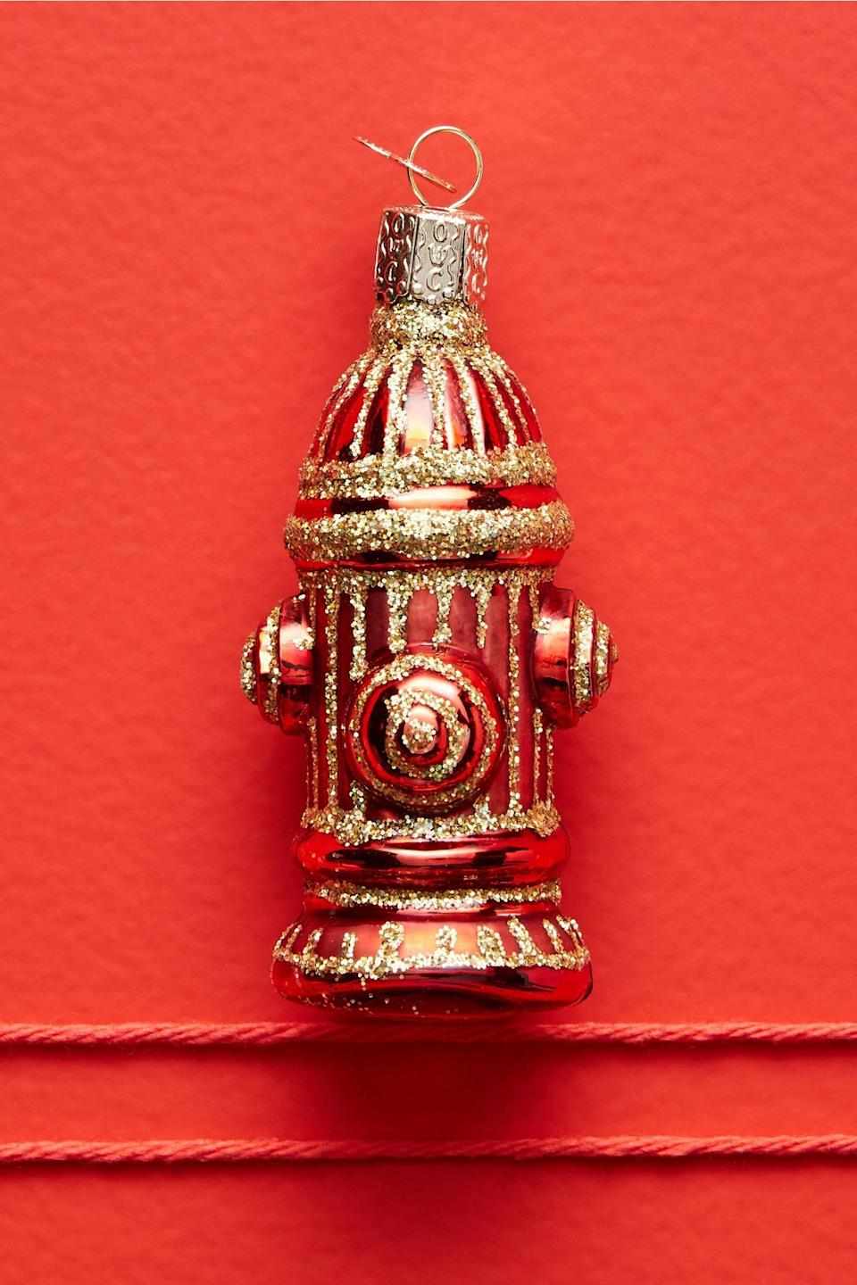 """<p>The <a href=""""https://www.popsugar.com/buy/Fire-Hydrant-Ornament-490568?p_name=Fire%20Hydrant%20Ornament&retailer=anthropologie.com&pid=490568&price=12&evar1=casa%3Aus&evar9=46615300&evar98=https%3A%2F%2Fwww.popsugar.com%2Fhome%2Fphoto-gallery%2F46615300%2Fimage%2F46615439%2FFire-Hydrant-Ornament&list1=shopping%2Canthropologie%2Choliday%2Cchristmas%2Cchristmas%20decorations%2Choliday%20decor%2Chome%20shopping&prop13=mobile&pdata=1"""" rel=""""nofollow noopener"""" class=""""link rapid-noclick-resp"""" target=""""_blank"""" data-ylk=""""slk:Fire Hydrant Ornament"""">Fire Hydrant Ornament</a> ($12) makes a great gift for firefighters. </p>"""