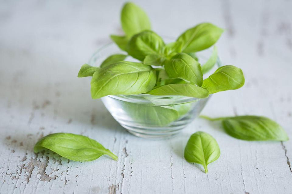 """<p>""""To quiet a cough and alleviate <strong>congestion</strong>, boil about 15 fresh basil leaves in 2 quarts of water with a spoonful of cloves (they're antimicrobial) until half the water remains. Stir in 1 tsp <a href=""""https://www.prevention.com/food-nutrition/a23691441/manuka-honey-benefits/"""" rel=""""nofollow noopener"""" target=""""_blank"""" data-ylk=""""slk:manuka honey"""" class=""""link rapid-noclick-resp"""">manuka honey</a> (a natural expectorant) and sip daily until you're feeling better."""" </p><p><em>—Caitlin Policastro, N.P., clinical director of the New York Center for Innovative Medicine</em></p>"""