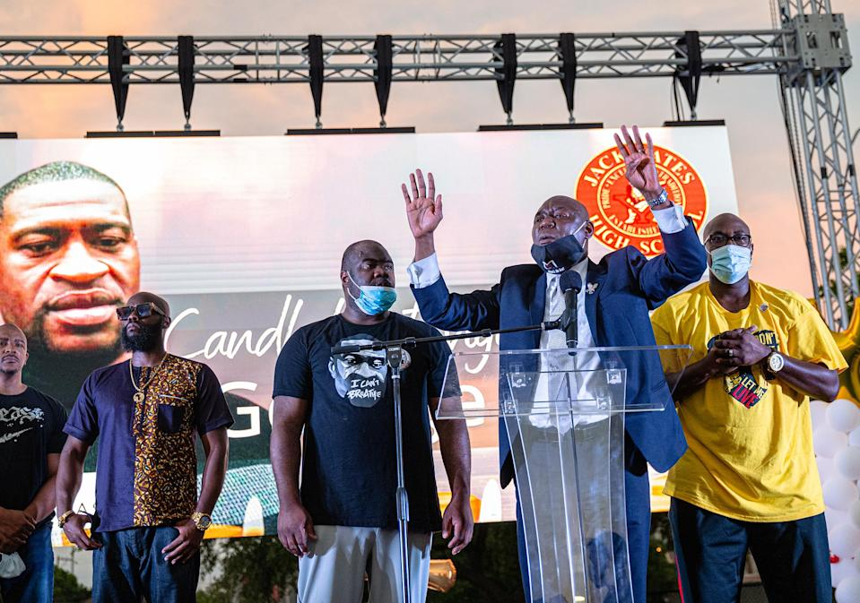 """Ben Crump speaks at a candlelight vigil honoring George Floyd at Jack Yates High School in Houston, June 8, 2020.<span class=""""copyright"""">Ruddy Roye for TIME</span>"""