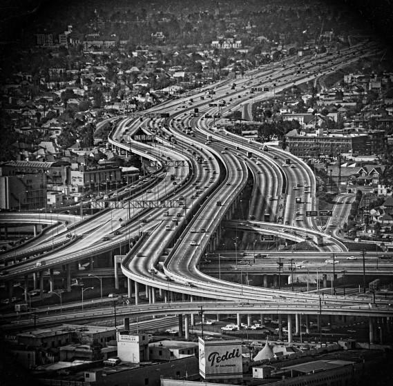 The mid-1960s witnessed L.A. freeway construction at its height. The original LACMA design put the museum on the other end of a bridge from busy streets.