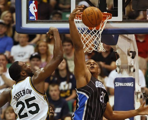 Orlando Magic's Danile Orton, right, grabs a rebound from Utah Jazz's Al Jefferson during the first half of an NBA basketball game in Salt Lake City, Saturday, April 21, 2012. (AP photo/George Frey)
