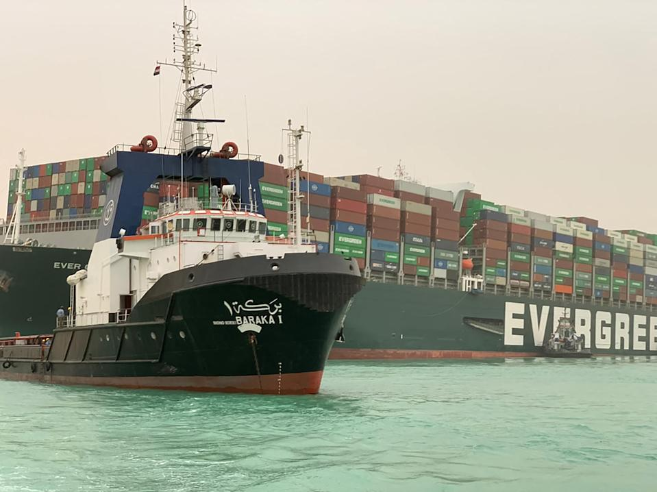 A handout picture released by the Suez Canal Authority on March 24, 2021 shows a part of the Taiwan-owned MV Ever Given (Evergreen), a 400-metre- (1,300-foot-) long and 59-metre wide vessel, lodged sideways and impeding all traffic across the waterway of Egypt's Suez Canal. - A giant container ship ran aground in the Suez Canal after a gust of wind blew it off course, the vessel's operator said on March 24, 2021, bringing marine traffic to a halt along one of the world's busiest trade routes. (Photo by Suez Canal Authority/Handout/AFP via Getty Images)