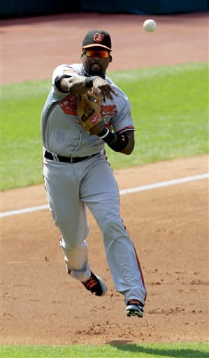 Baltimore Orioles' Wilson Betemit throws out Cleveland Indians' Aaron Cunningham at first base in the third inning in a baseball game, Sunday, July 22, 2012, in Cleveland. (AP Photo/Tony Dejak)