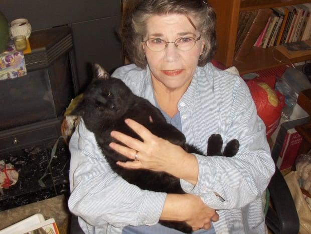 Prince George pet-lover Lutrecia MacDonell, and 'Noir,' reunited after a five year absence.  (Lutrecia MacDonell - image credit)