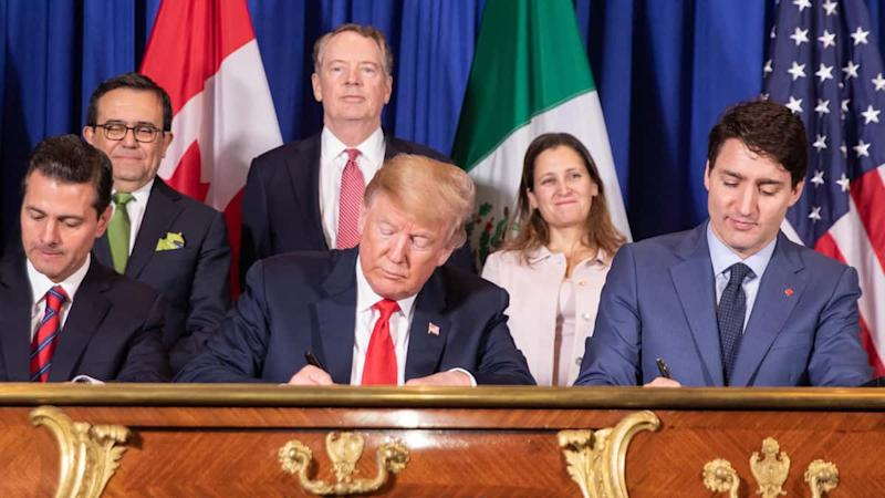 The leaders of Mexico, the United States and Canada sign the USMCA.
