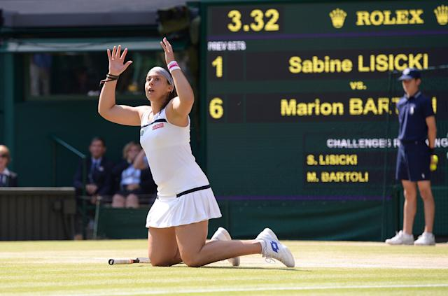 France's Marion Bartoli celebrates defeating Germany's Sabine Lisicki during day twelve of the Wimbledon Championships at The All England Lawn Tennis and Croquet Club, Wimbledon.