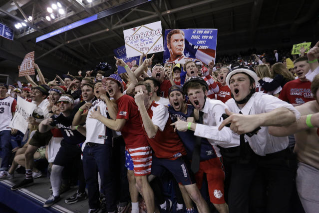 Members of the Gonzaga student section have been dressing up like Mormon missionaries at BYU games, and the school wants them to stop. (AP Photo)