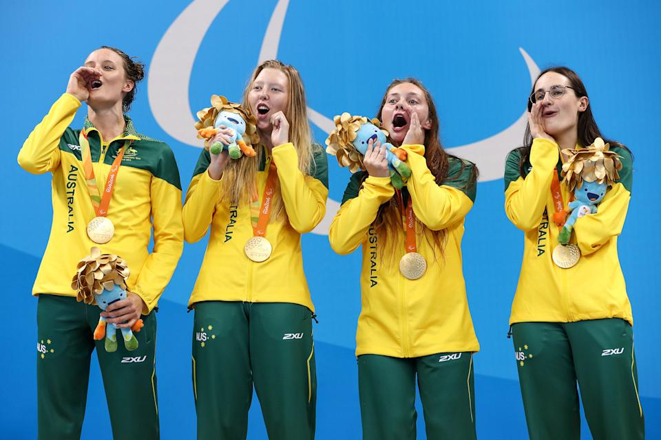 Gold medalists Ellie Cole, Lakeisha Patterson, Maddison Elliott and Ashleigh McConnell of Australia celebrates on the podium at the medal ceremony for the Women's 4x100m Freestyle Relay - 34 Points Final during Day 8 of the Rio 2016 Paralympic Games at the Olympic Aquatics Stadium on September 15, 2016 in Rio de Janeiro, Brazil.