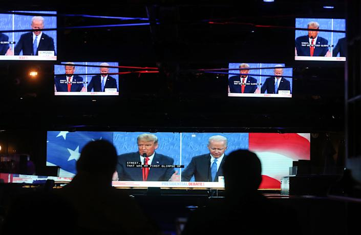 Viewers sitting outdoors in West Hollywood, California, watched Thursday's presidential debate on TV, as millions of Americans did.