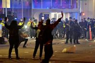 Police clash with protesters after a demonstration in Boston