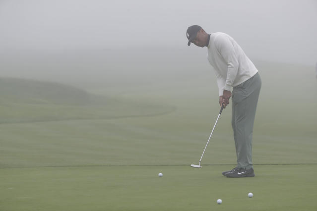 Tiger Woods putts in the fog on the 13th hole during a practice round for the U.S. Open Championship golf tournament Wednesday, June 12, 2019, in Pebble Beach, Calif. (AP Photo/Matt York)