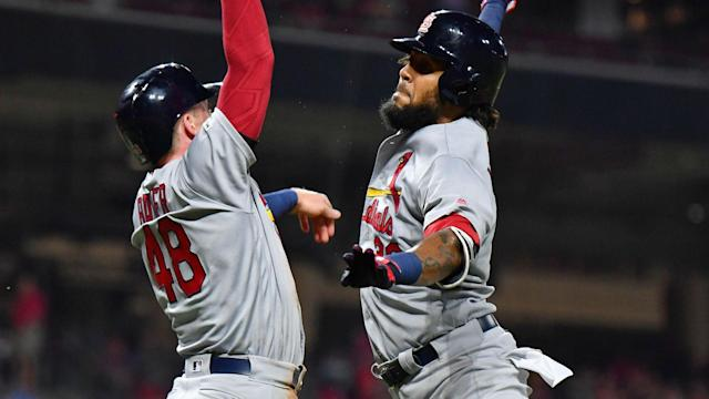 The St Louis Cardinals came from 7-0 down in the sixth inning to defeat the Cincinnati Reds 12-11 at Great American Ball Park.