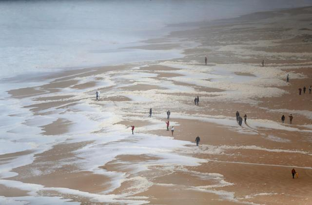 People gather to watch big waves at Praia do Norte in Nazare, Portugal. (Reuters)