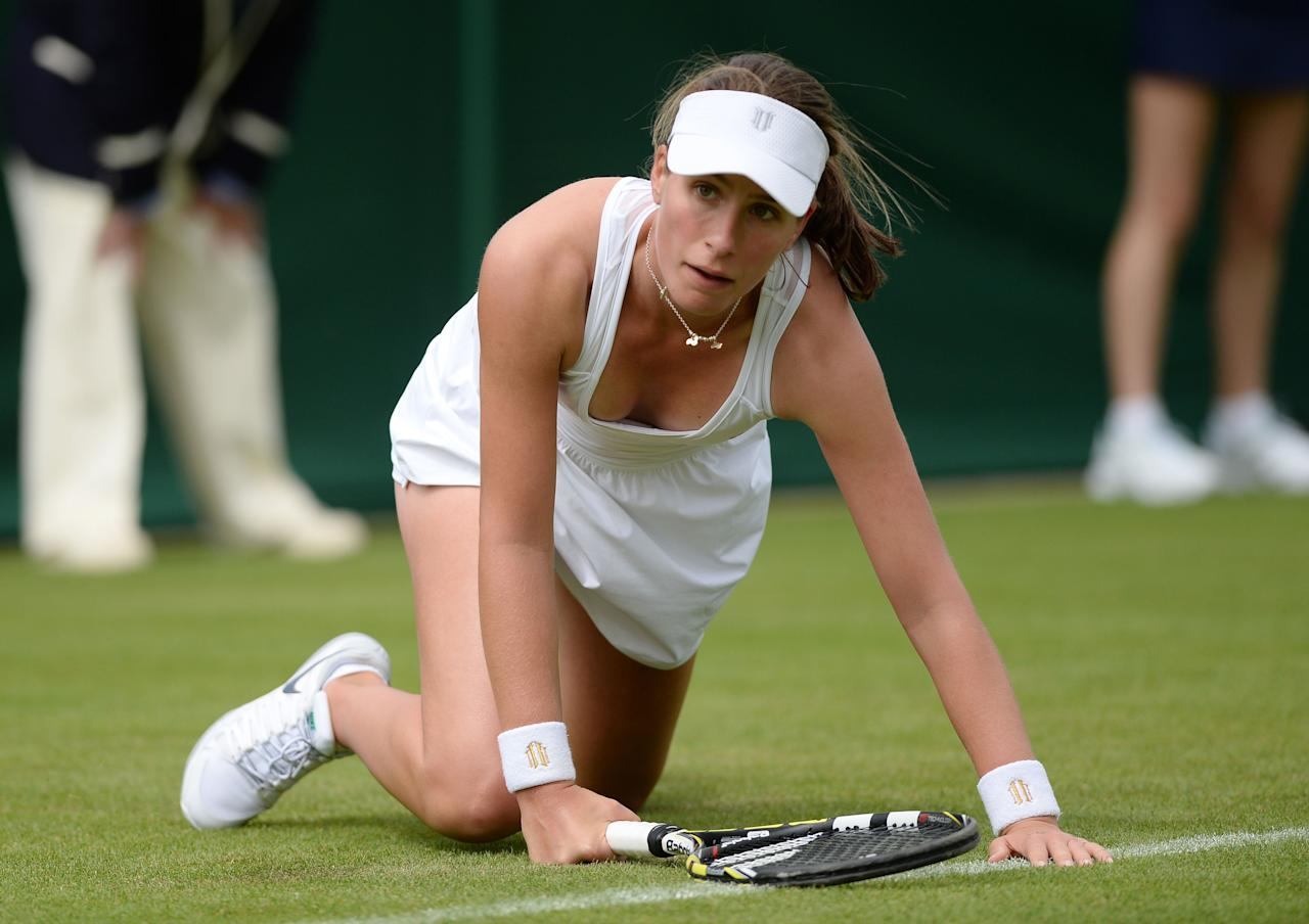 Great Britain's Johanna Konta slips in her match against Serbia's Jelena Jankovic during day one of the Wimbledon Championships at The All England Lawn Tennis and Croquet Club, Wimbledon.