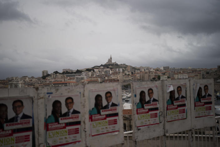 Electoral campaign boards are pictured during regional elections in Marseille, southern France, Sunday, June 20, 2021. Marine Le Pen's far-right party is riding high on her tough-on-security, stop-immigration message as French voters started choosing regional leaders Sunday in an election that many see as a dress rehearsal for next year's presidential vote. (AP Photo/Daniel Cole)