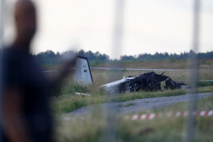 A small aircraft is seen after crashing at Orebro Airport in Sweden
