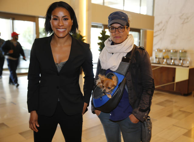 Norwegian female boxing star Cecilia Braekhus, left, arrives with her trainer, Lucia Rijker, at a news conference in Los Angeles Wednesday, May 2, 2018. Braekhus will fight against Kali Reis during the boxing event at StubHub Center in Carson, Calif., on Saturday, May, 5. (AP Photo/Damian Dovarganes)
