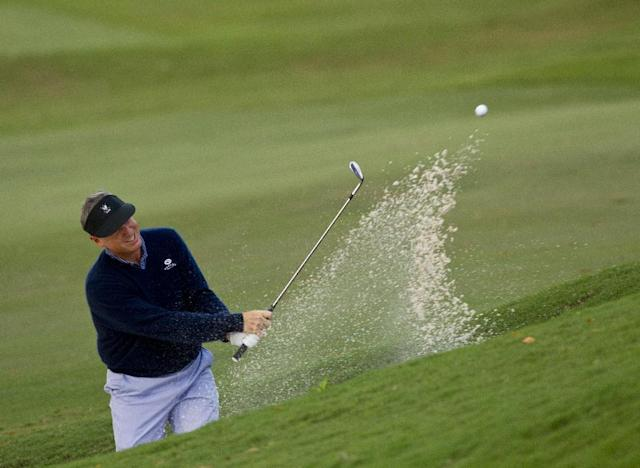In a photo provided by the USGA, Michael McCoy plays his third shot from a greenside bunker on the second hole during the quarterfinal round of match play at the U.S. Mid-Amateur Championship at Country Club of Birmingham in Birmingham, Ala., on Wednesday, Oct. 9, 2013. McCoy defeated Bradley Bastion 7 and 6. (AP Photo/USGA, Steve Gibbons)