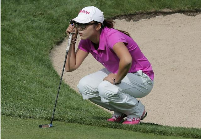 Lydia Ko, of New Zealand, studies her putt before playing on the 5th green during the third and last round of the Evian Championship women's golf tournament in Evian, eastern France, Sunday, Sept. 15, 2013. (AP Photo/Laurent Cipriani)