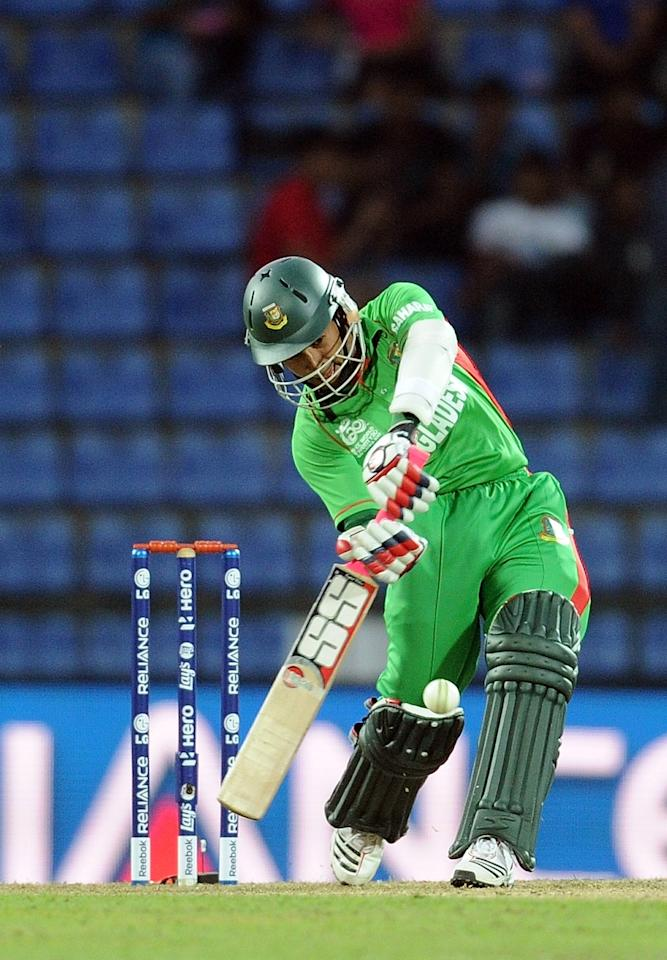 Bangladesh batsman Mushfiqur Rahim plays a shot during the ICC Twenty20 Cricket World Cup match between Bangladesh and New Zealand at The Pallekele International Cricket Stadium in Pallekele  on September 21, 2012. AFP PHOTO/ Prakash SINGH