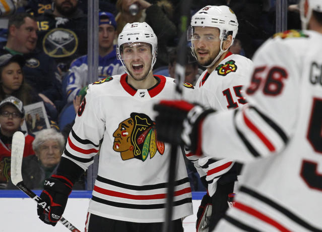 Chicago Blackhawks forwards Thomas Jurco (13) and Artem Anisimov (15) celebrate a goal during the second period of an NHL hockey game against the Buffalo Sabres, Saturday, March 17, 2018, in Buffalo, N.Y. (AP Photo/Jeffrey T. Barnes)