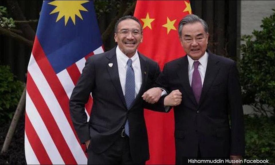 Foreign Minister Hishammuddin Hussein (left) and his Chinese counterpart Wang Yi
