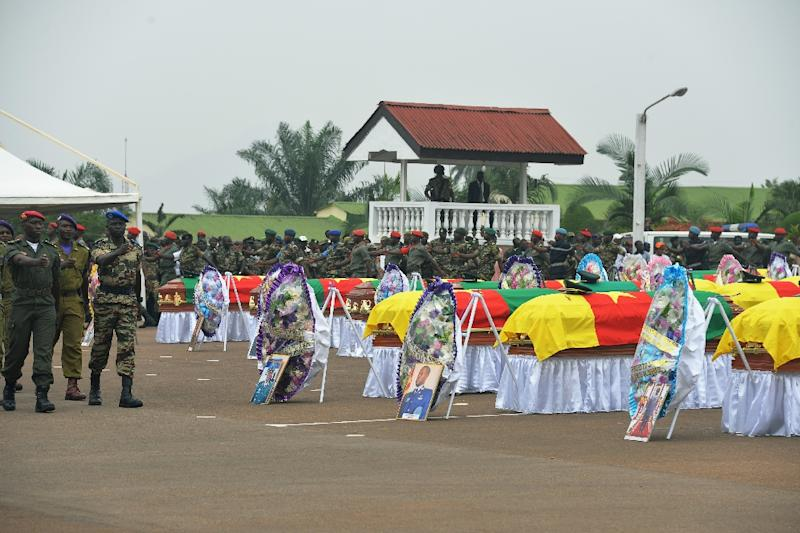 Cameroonian soldiers march around coffins during a ceremony for 38 soldiers who died in the north of the country while fighting Islamist Boko Haram militants, at the military headquarters in Yaounde on March 6, 2015