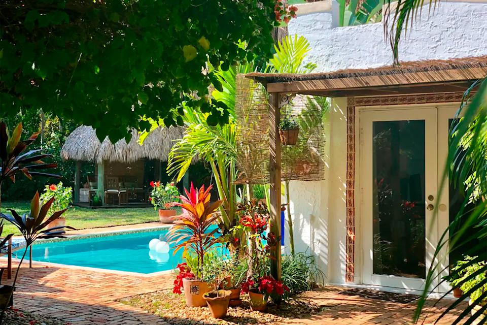 """<h2>Cozy And Charming Cottage</h2><br>Florida-based couples can check out this cozy pool house, which isn't too far from the coast on the outskirts of Miami. <a href=""""https://www.refinery29.com/en-us/2020/05/9840778/best-commuter-bikes-online"""" rel=""""nofollow noopener"""" target=""""_blank"""" data-ylk=""""slk:Bikes are available for guests to use"""" class=""""link rapid-noclick-resp"""">Bikes are available for guests to use</a>, and so is the enormous pool in the cottage's yard.<br><br><strong>Location: </strong>Biscayne Park, FL<br><strong>Sleeps: </strong>2<br><strong>Price Per Night: </strong>$100<br><br><strong><a href=""""https://www.airbnb.com/rooms/4293449"""" rel=""""nofollow noopener"""" target=""""_blank"""" data-ylk=""""slk:Book here"""" class=""""link rapid-noclick-resp"""">Book here</a></strong><span class=""""copyright"""">Photo: Courtesy of Airbnb.</span>"""
