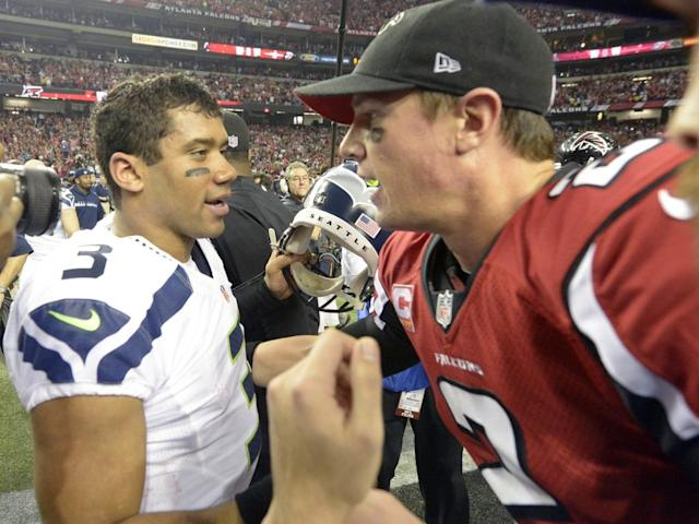 Jan 13, 2013; Atlanta, GA, USA; Seattle Seahawks quarterback Russell Wilson (3) congratulates Atlanta Falcons quarterback Matt Ryan (2) after the Falcons defeated the Seahawks 30-28 in the NFC divisional playoff game at the Georgia Dome. Mandatory Credit: John David Mercer-USA TODAY Sports