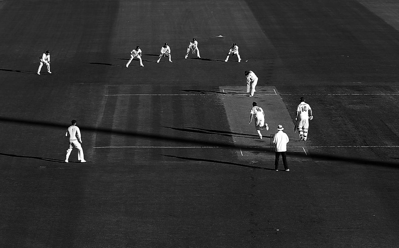 HOBART, AUSTRALIA - MARCH 23:  (EDITORS NOTE: This image has been converted to black and white.)  Greg Moller of the Bulls is bowled by Ben Hilfenhaus of the Tigers in the first ball of Queensland's innings during day two of the Sheffield Shield final between the Tasmania Tigers and the Queensland Bulls at Blundstone Arena on March 23, 2013 in Hobart, Australia.  (Photo by Mark Metcalfe/Getty Images)