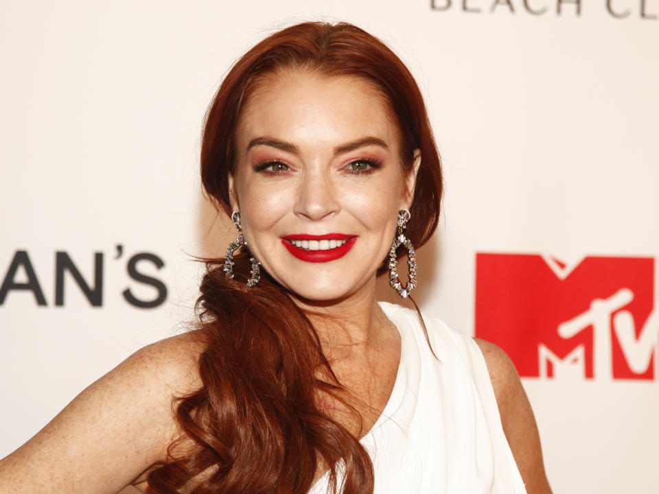 """Lindsay Lohan attends MTV's """"Lindsay Lohan's Beach Club"""" series premiere party at Magic Hour Rooftop at The Moxy Times Square on Monday, Jan. 7, 2019, in New York. (Photo by Andy Kropa/Invision/AP)"""