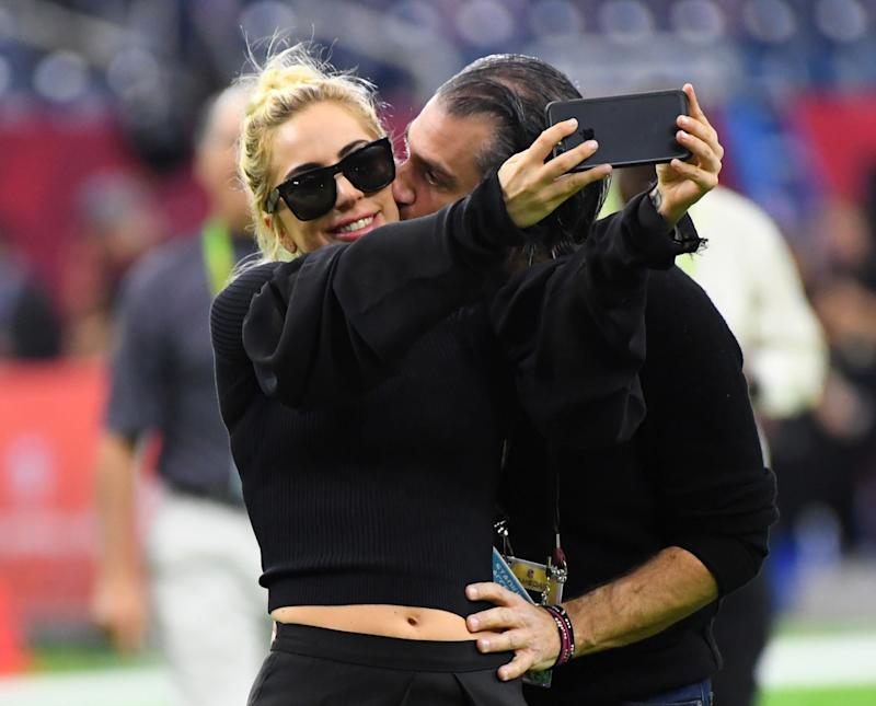 Lady Gaga gets a kiss from Christian Carino before Super Bowl LI. (USA Today Sports / Reuters)