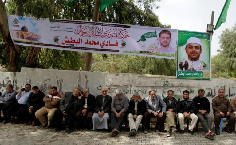 Palestinians gather in mourning outside the family home of 35-year-old professor and Hamas member Fadi Mohammad al-Batsh, who was killed in Malaysia, in Jabalia in northern Gaza