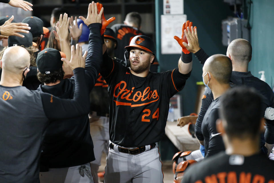 Baltimore Orioles' DJ Stewart (24) is congratulated by teammates after a home run in the fifth inning of the team's baseball game against the Texas Rangers in Arlington, Texas, Friday, April 16, 2021. (AP Photo/Roger Steinman)
