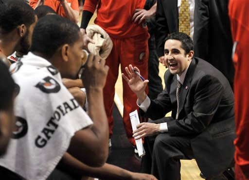 Portland Trail Blazers head coach Kaleb Canales talks to his team during a timeout in the first quarter of an NBA basketball game against the Chicago Bulls, Friday, March 16, 2012, in Chicago. (AP Photo/Brian Kersey)