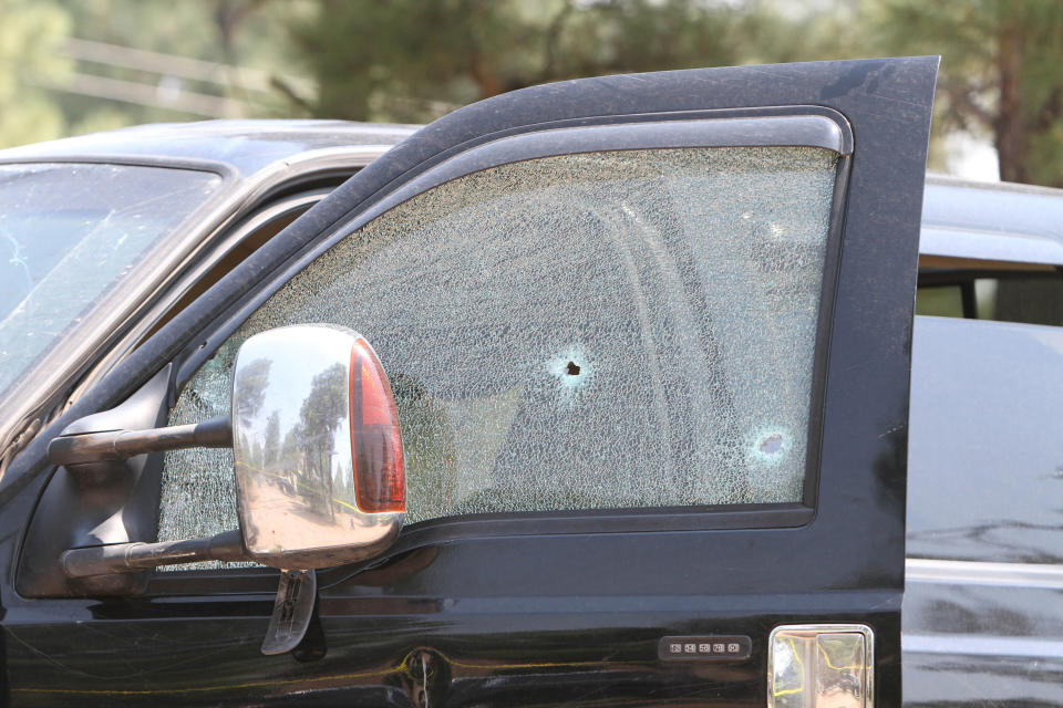 In this Saturday, June 19, 2021, photo courtesy of The White Mountain Independent is a damaged pickup truck which ran over a group of cyclists in Show Low, Ariz. Police say a driver in the pickup truck plowed into bicyclists competing in a community road race in Arizona, critically injuring several riders. Authorities say officers then chased down the driver Saturday and shot him outside a nearby hardware store. (Jim Headley/The White Mountain Independent via AP)