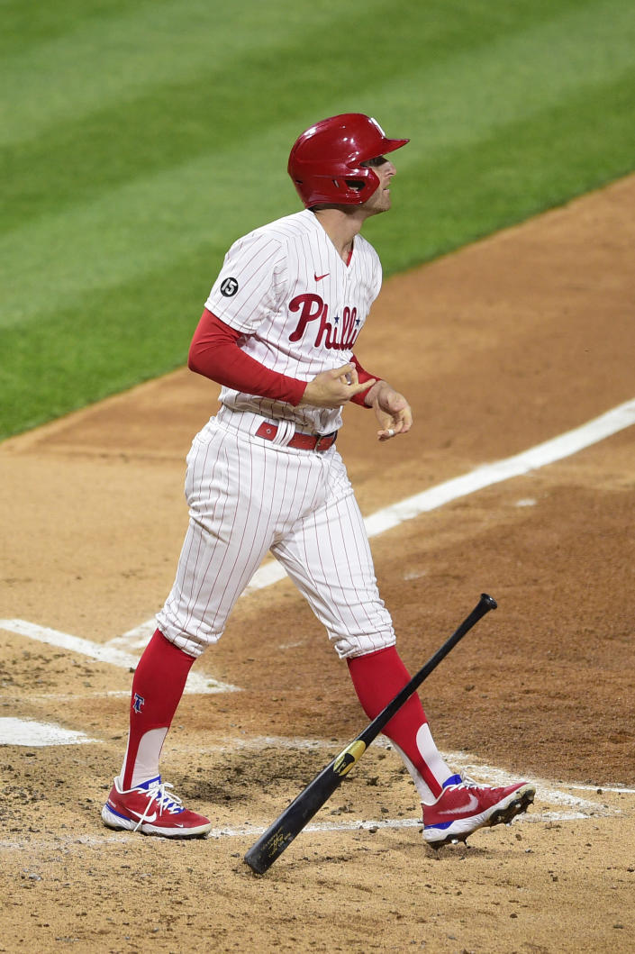 Philadelphia Phillies' Brad Miller watches the ball after hitting a three-run home run off Milwaukee Brewers' Eric Lauer during the third inning of a baseball game, Tuesday, May 4, 2021, in Philadelphia. (AP Photo/Derik Hamilton)