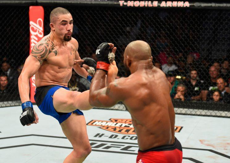 Robert Whittaker (L) and Yoel Romero trade blows during their UFC 213 title fight. (Getty)