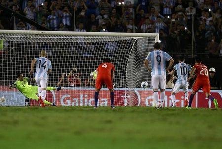 Football Soccer - Argentina v Chile - World Cup 2018 Qualifiers - Antonio Liberti Stadium, Buenos Aires, Argentina - 23/3/17 - Argentina's Lionel Messi (10) kicks a penalty. REUTERS/Marcos Brindicci