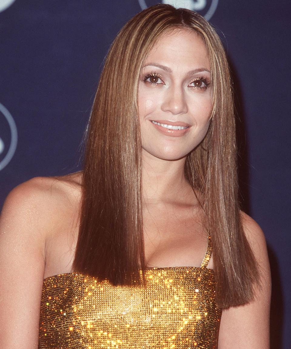 """<h3>1999</h3><br>Before blunt ends were all the rave in big-city salons, Lopez rocked a stunning geometric style to the 44th Annual Grammy Awards.<span class=""""copyright"""">Photo: Steve Granitz/WireImage.</span>"""