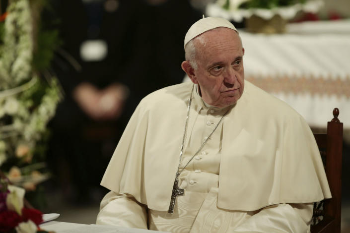 Pope Francis sits during a meeting with Catholic priests and other Christian representatives in the cathedral of the capital, Rabat, Morocco, Sunday, March 31, 2019. Pope Francis is in Morocco for a two-day trip aimed at highlighting the North African nation's Christian-Muslim ties, while also showing solidarity with migrants at Europe's door and tending to a tiny Catholic flock. (AP Photo/Mosa'ab Elshamy)