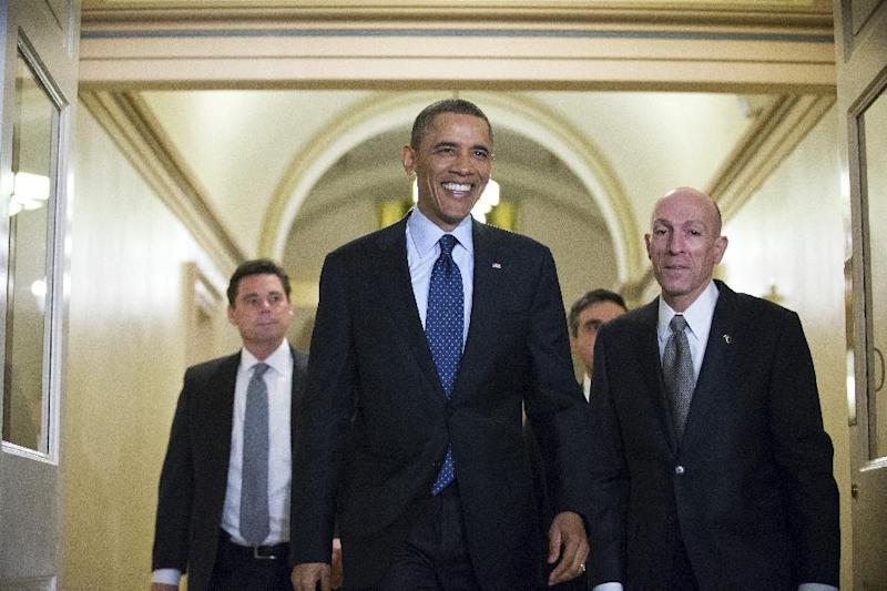 President Barack Obama, escorted by House Sergeant at Arms Paul Irving, right, arrives on Capitol Hill in Washington, Wednesday, March 13, 2013, for closed-door talks with House Speaker John Boehner and the House Republican Conference to discuss the budget. (AP Photo/J. Scott Applewhite)