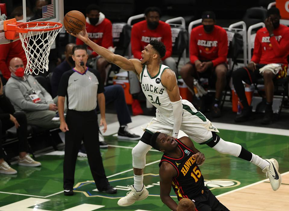 MILWAUKEE, WISCONSIN - JUNE 25: Giannis Antetokounmpo #34 of the Milwaukee Bucks goes up for a shot against Clint Capela #15 of the Atlanta Hawks during the second half in game two of the Eastern Conference Finals at Fiserv Forum on June 25, 2021 in Milwaukee, Wisconsin. NOTE TO USER: User expressly acknowledges and agrees that, by downloading and or using this photograph, User is consenting to the terms and conditions of the Getty Images License Agreement. (Photo by Stacy Revere/Getty Images)