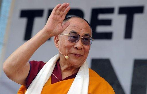 Tibet's exiled spiritual leader the Dalai Lama attends a rally in Vienna